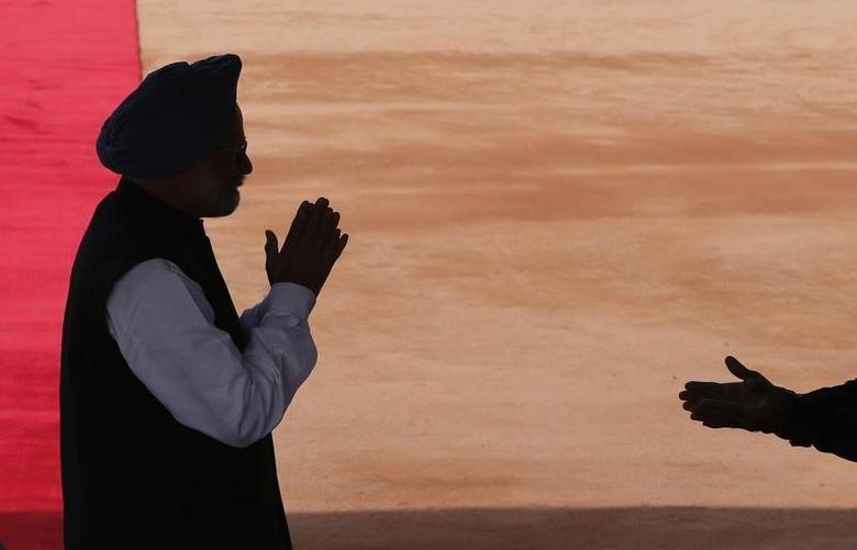 Manmohan Singh greets a guest as he arrives to attend the ceremonial reception of Canada's Governor General David Johnston at the forecourt of India's Rashtrapati Bhavan presidential palace in New Delhi February 24, 2014. REUTERS/Adnan Abidi/Files