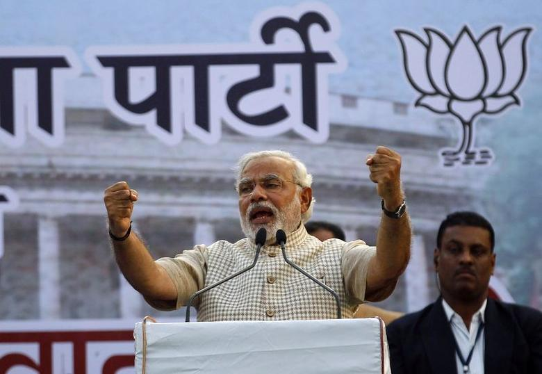 Narendra Modi, the prime ministerial candidate for Bharatiya Janata Party (BJP), gestures as he addresses his supporters during a public meeting in Vadodra in Gujarat May 16, 2014.  REUTERS/Amit Dave