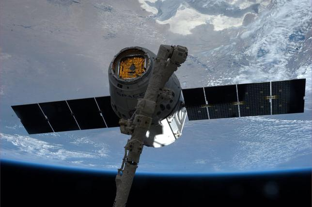 The SpaceX Dragon commercial cargo spacecraft is grappled to Canadarm2 at the International Space Station in this NASA picture taken April 20, 2014.  REUTERS/NASA/Handout via Reuters