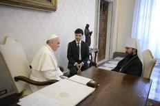 Pope Francis (L) talks with Metropolitan Hilarion, the foreign minister of the Russian Orthodox Church, during a private meeting at the Vatican March 20, 2013.    REUTERS/Osservatore Romano