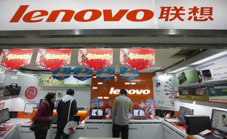 Customers talk to a salesperson about a new laptop at a Lenovo shop in Shanghai February 17, 2011. REUTERS/Aly Song/Files