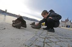 An Orthodox Jewish boy visits a Holocaust memorial at the Danube river in Budapest March 24, 2014. REUTERS/Laszlo Balogh