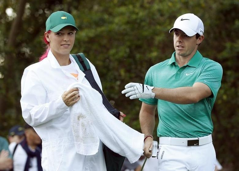 Caroline Wozniacki and Rory McIlroy at the Augusta National Golf Club in Augusta, Georgia April 9, 2014. REUTERS/Mike Segar/Files