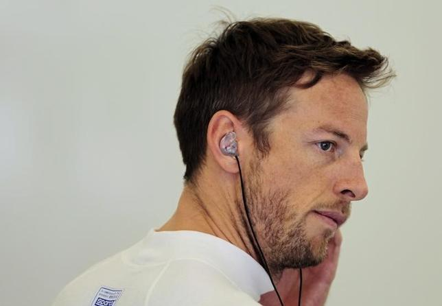 McLaren Formula One driver Jenson Button of Britain looks on during the first practice session of the Bahrain F1 Grand Prix at the Bahrain International Circuit (BIC) in Sakhir, south of Manama April 4, 2014. REUTERS/Caren Firouz