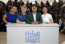 "Director Xavier Dolan (2ndR), cast members Suzanne Clement (L), Antoine-Olivier Pilon (2ndL) and Anne Dorval (R) pose during a photocall for the film ""Mommy"" in competition at the 67th Cannes Film Festival in Cannes May 22, 2014.             REUTERS/Eric Gaillard"