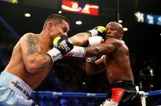 May 3, 2014; Las Vegas, NV, USA; Floyd Mayweather Jr. (right) is punched by Marcos Maidana during their fight at MGM Grand. Mandatory Credit: Mark J. Rebilas-USA TODAY Sports