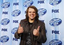 Winner Caleb Johnson poses backstage at the American Idol XIII 2014 Finale in Los Angeles, California May 21, 2014.  REUTERS/Danny Moloshok