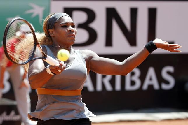 Serena Williams of the U.S. hits a return to Sara Errani of Italy during their women's singles final match at the Rome Masters tennis tournament May 18, 2014. REUTERS/Giampiero Sposito