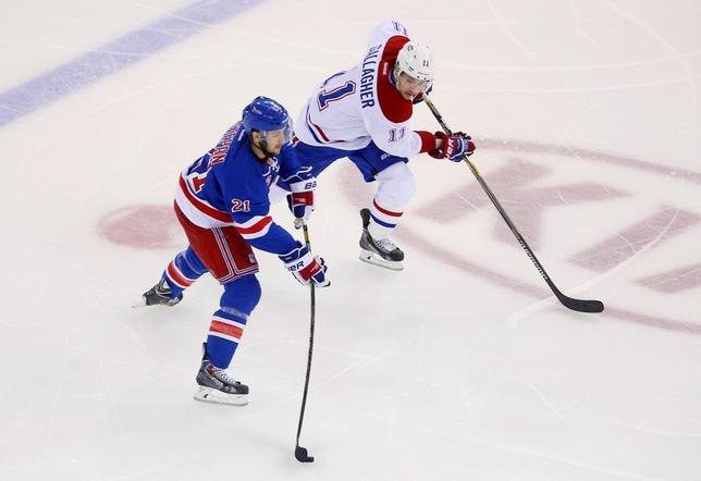 May 22, 2014; New York, NY, USA; New York Rangers center Derek Stepan (21) carries the puck past Montreal Canadiens right wing Brendan Gallagher (11) during the second period in game three of the Eastern Conference Final of the 2014 Stanley Cup Playoffs at Madison Square Garden. Mandatory Credit: Ed Mulholland-USA TODAY Sports