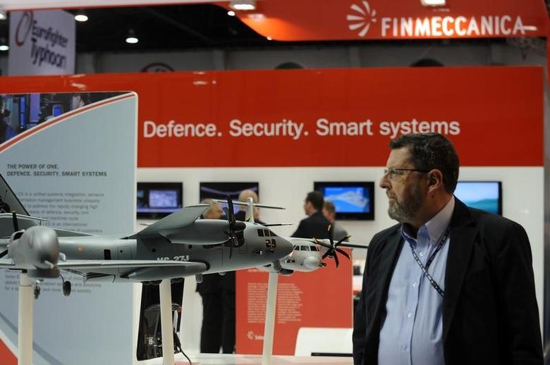 A visitor walks past a stand for Italian defence group Finmeccanica during the International Defence Exhibition and Conference (IDEX) at the Abu Dhabi National Exhibition Centre February 19, 2013. REUTERS/Ben Job