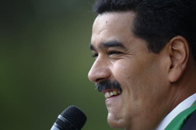 Venezuela's President Nicolas Maduro speaks to media in Caracas May 16, 2014. REUTERS/Jorge Silva