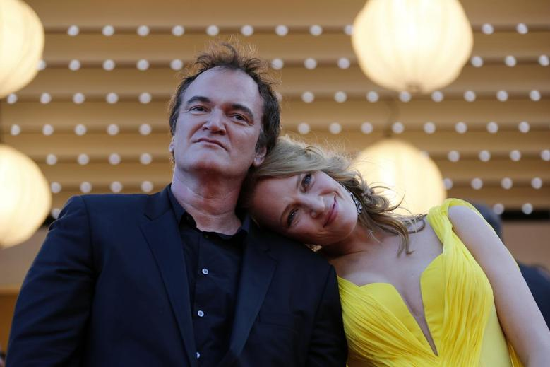 Director Quentin Tarantino (L) and actress Uma Thurman pose on the red carpet they arrive for the screening of the film ''Sils Maria'' (Clouds of Sils Maria) in competition at the 67th Cannes Film Festival in Cannes May 23, 2014. REUTERS/Regis Duvignau