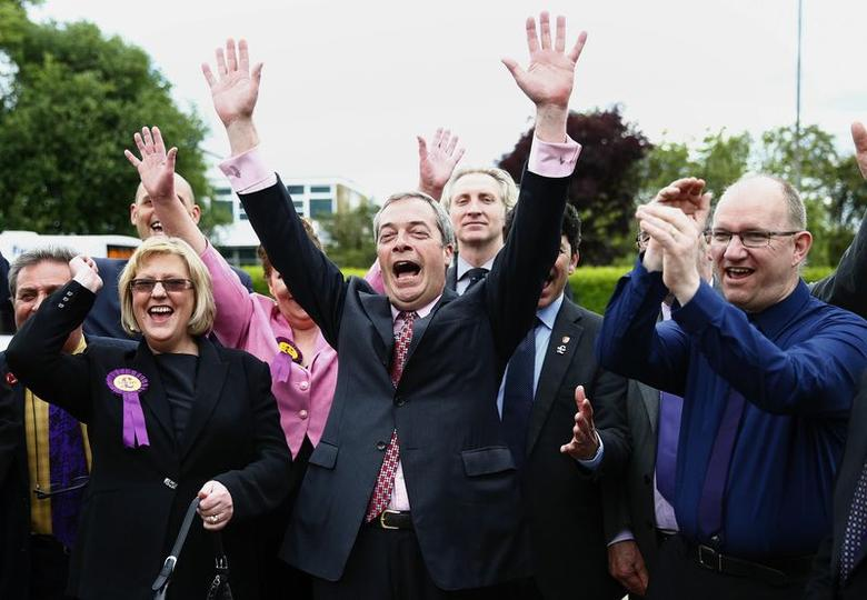 The leader of Britain's United Kingdom Independence Party (UKIP), Nigel Farage (C), celebrates with newly elected councillors in Basildon, southern England May 23, 2014.     REUTERS/Andrew Winning