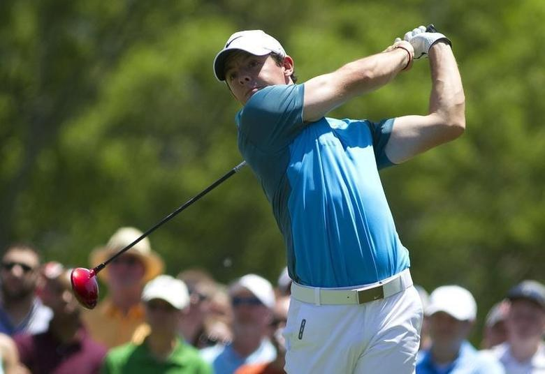 May 4, 2014; Charlotte, NC, USA; Rory McIlroy tees off on the fourth hole during the final round of the Wells Fargo Championship at Quail Hollow Club. REUTERS/Joshua