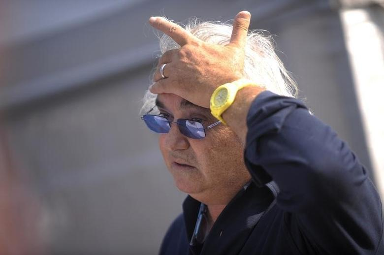 Former Renault F1 principal Flavio Briatore gestures in the paddock after the qualifying session of the Italian F1 Grand Prix at the Monza circuit September 10, 2011. REUTERS/Giorgio Perottino