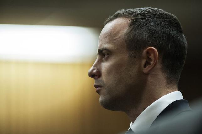South African Olympic and Paralympic track star Oscar Pistorius sits in the dock, during the trial for the murder of his girlfriend Reeva Steenkamp, in the North Gauteng High Court in Pretoria, May 14, 2014.   REUTERS/Gianluigi Guercia