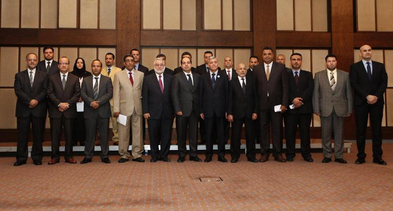 Libya's new Prime Minister Ahmed Maiteeq (6th L), President of the General National Congress Nouri Abusahmain (7th L) and other members of the new Libyan government pose for a group photo in Tripoli May 26, 2014. REUTERS/Ismail Zitouny