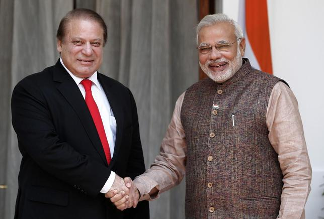 India's Prime Minister Narendra Modi (R) shakes hands with his Pakistani counterpart Nawaz Sharif before the start of their bilateral meeting in New Delhi May 27, 2014.  REUTERS/Adnan Abidi