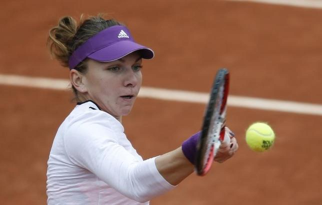 Simona Halep of Romania returns a forehand to Alisa Kleybanova of Russia during their women's singles match at the French Open tennis tournament at the Roland Garros stadium in Paris May 27, 2014.                REUTERS/Vincent Kessler