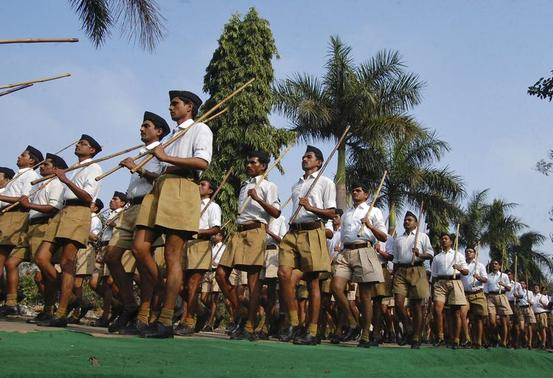 Activists from the Rashtriya Swayamsevak Sangh (RSS), a Hindu hardline group, hold bamboo sticks as they take part in a march in Bhopal February 23, 2014. REUTERS/Raj Patidar/Files