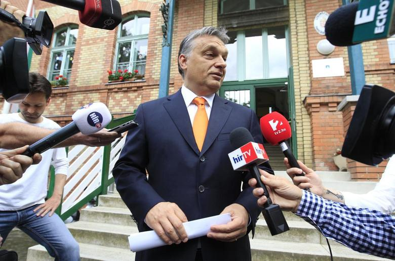 Hungary's Prime Minister Viktor Orban talks to journalists after casting his vote during European Parliamentary elections in Budapest, May 25, 2014. REUTERS/Bernadett Szabo