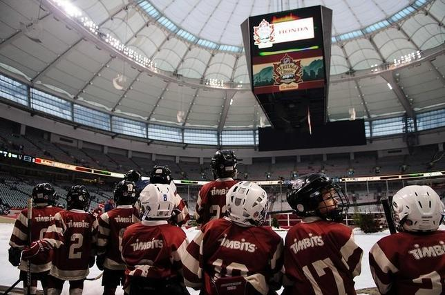 Mar 2, 2014; Vancouver, British Columbia, CAN; Youth hockey players prepare to skate on a miniature rink before the Heritage Classic hockey game between the Vancouver Canucks and Ottawa Senators  at BC Place. Mandatory Credit: Anne-Marie Sorvin-USA TODAY Sports -