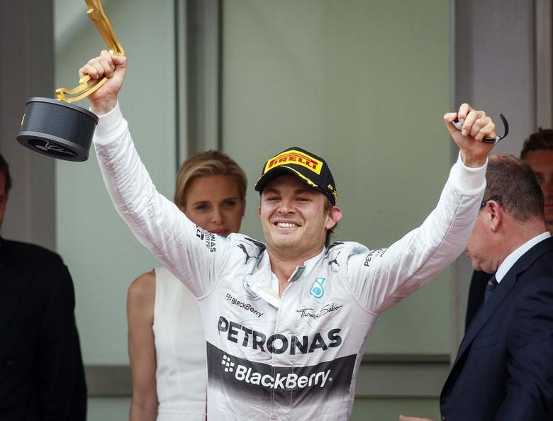 Mercedes Formula One driver Nico Rosberg of Germany celebrates on the podium after winning the Monaco Grand Prix in Monaco May 25, 2014. REUTERS/Robert Pratta