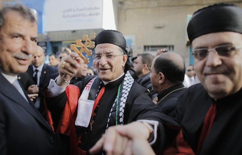 Maronite Patriarch Beshara al-Rai (C) greets members of the Christian community during his visit to the West Bank town of Bethlehem May 27, 2014. REUTERS/Ammar Awad