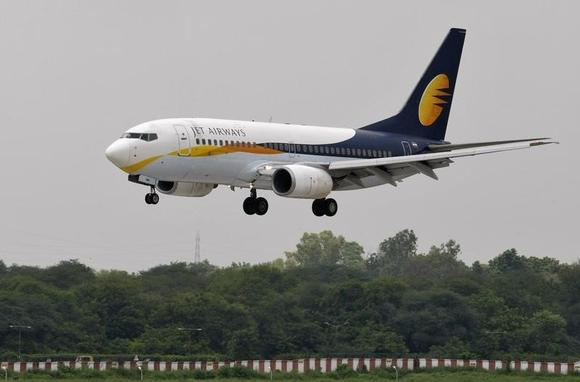 A Jet Airways passenger aircraft prepares to land at the airport in Ahmedabad August 12, 2013. REUTERS/Amit Dave/Files