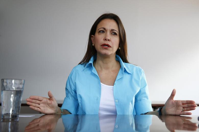 Venezuelan opposition leader Maria Corina Machado speaks during an interview with Reuters in Caracas May 23, 2014. REUTERS/Jorge Silva