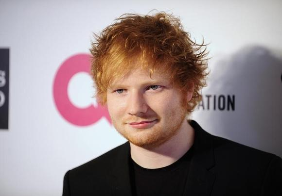 Musician Ed Sheeran arrives at the 2014 Elton John AIDS Foundation Oscar Party in West Hollywood, California March 2, 2014. REUTERS/Gus Ruelas/Files