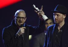 Will Champion (L) and Jonny Buckland of Coldplay react after winning the British Live Act category during the BRIT Awards, celebrating British pop music, at the O2 Arena in London February 20, 2013.   REUTERS/Dylan Martinez