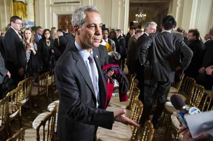 Chicago Mayor Rahm Emanuel greets a reporter after U.S. President Barack Obama delivered remarks on manufacturing innovation institutes in the East Room of the White House in Washington on February 25, 2014.      REUTERS/Joshua Roberts