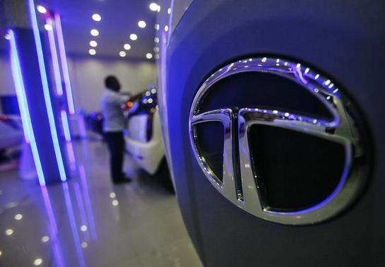 A worker cleans a Tata Motors vehicle inside the company's showroom on the outskirts of Agartala, capital of Tripura, November 7, 2012. REUTERS/Jayanta Dey/Files