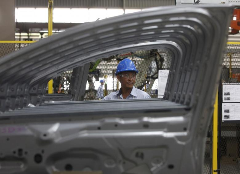 An employee works at an assembly line at the new Ford Thailand manufacturing plant located in Rayong province, East of Bangkok in this May 3, 2012 file photo.REUTERS/Chaiwat Subprasom/Files