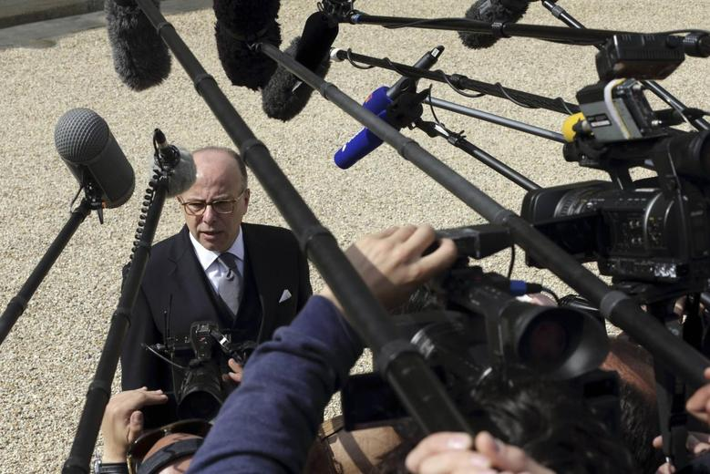 French Interior Minister Bernard Cazeneuve speaks to journalists as he leaves the Elysee Palace in Paris, following the weekly cabinet meeting, April 23, 2014. REUTERS/Philippe Wojazer
