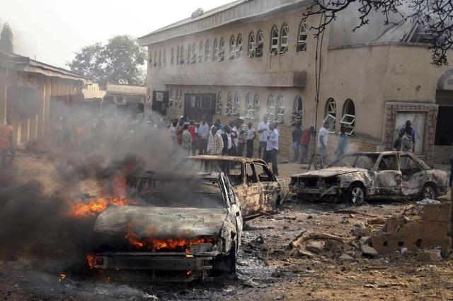 A car burns at the scene of a Christmas Day bomb explosion that the Islamist militant group Boko Haram claimed responsibility for at St. Theresa Catholic Church at Madalla, Suleja, just outside Nigeria's capital Abuja in this file photo taken December 25, 2011. REUTERS/Afolabi Sotunde/Files