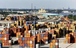 Containers await departure as crews load and unload consumer products at the Port of New Orleans along the Mississippi River in New Orleans, Louisiana June 23, 2010. REUTERS/Sean Gardner
