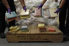 Cocaine from Britain's largest ever cocaine seizure is displayed by UK Border Agency staff in London August 3, 2011.   REUTERS/Stefan Wermuth