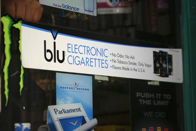 An advertisement for the e-cigarette brand blu is seen on the window of a store in New York May 27, 2014. REUTERS/Shannon Stapleton