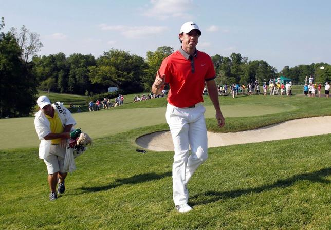May 29, 2014; Dublin, OH, USA; Rory McIlroy leaves the course as the leader after completing the first round of the Memorial Tournament at Muirfield Village Golf Club. Mandatory Credit: Joe Maiorana-USA TODAY Sports