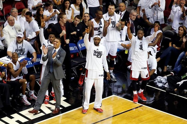 May 30, 2014; Miami, FL, USA; Miami Heat players LeBron James (middle) and Dwyane Wade (right) lead their coaches and teammates in celebration during the second half in game six of the Eastern Conference Finals of the 2014 NBA Playoffs against the Indiana Pacers at American Airlines Arena. Mandatory Credit: Robert Mayer-USA TODAY Sports