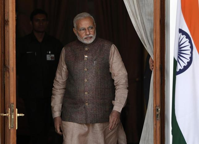 Prime Minister Narendra Modi comes out of a meeting room to receive his Bhutanese counterpart Tshering Tobgay before the start of their bilateral meeting in New Delhi May 27, 2014. REUTERS/Adnan Abidi
