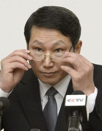 South Korean missionary, identified by the North as Kim Jong Uk, adjusts his glasses during a news conference in Pyongyang in this February 27, 2014 picture provided by Kyodo. REUTERS/Kyodo