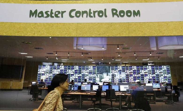 A journalist walks past by the Master Control Room during a media tour at the opening ceremony of the International Brodcasting Centre (IBC) for the 2014 FIFA World Cup, in Rio de Janeiro, June 2, 2014. REUTERS/Sergio Moraes
