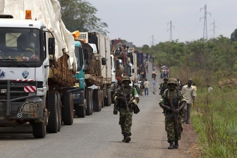 African Union (AU) peacekeepers guard a commercial convoy making its way to the border of Cameroon, near Bangui March 8, 2014. Picture taken March 8, 2014. REUTERS/Siegfried Modola