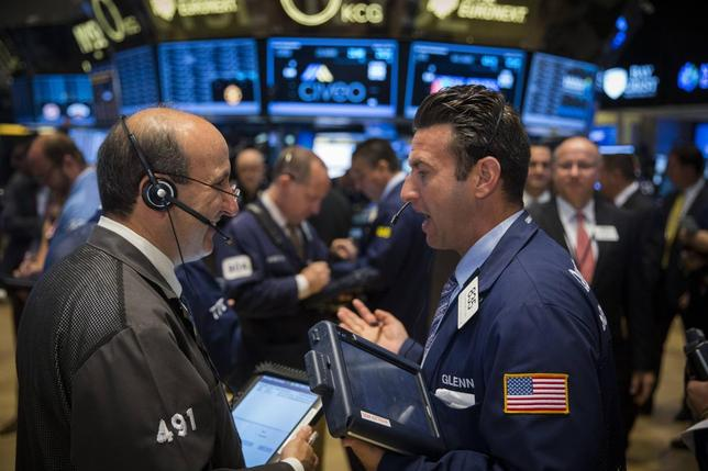 Traders work on the floor of the New York Stock Exchange shortly after the opening bell in New York, June 2, 2014. REUTERS/Lucas Jackson