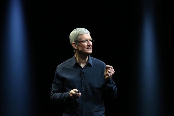 Apple CEO Tim Cook delivers his keynote address at the World Wide developers conference in San Francisco, California June 2, 2014. REUTERS/Robert Galbraith