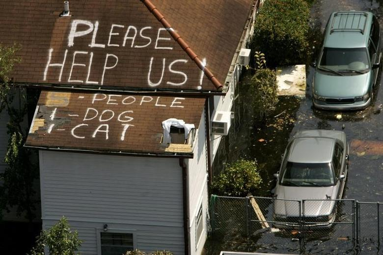 A plea for help is seen on the roof of a home flooded in the aftermath of Hurricane Katrina in New Orleans, Louisiana September 4, 2005.