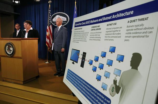 U.S. Assistant Attorney General Leslie Caldwell (at podium) of the Justice Department's Criminal Division announces criminal charges and two global cyber fraud disruptions, Gameover Zeus and Cyrptolocker, at the Department of Justice in Washington June 2, 2014.  REUTERS/Gary Cameron
